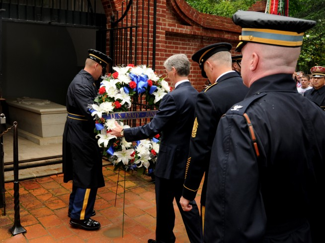 U.S. Army Sgt. 1st Class Brody O'Farrell, left, a platoon sergeant and Commander in Chief's Guard, assigned to the 3rd U.S. Infantry Regiment (The Old Guard) and Secretary of the Army John McHugh, center, lay a wreath at the tomb of Gen. George Washington at Mount Vernon, Va., June 10, 2013. The wreath laying ceremony was conducted to commemorate the upcoming U.S. Army's 238th birthday observance, June 14. Image credit: Sgt. Jose A. Torres Jr. Caption credit: DVIDSHUB